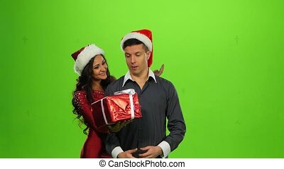 Christmas holiday couple, gift box present. green screen