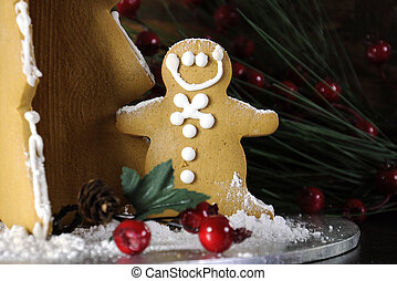 Christmas holiday gingerbread man and tree against dark wood rustic background. Closeup.