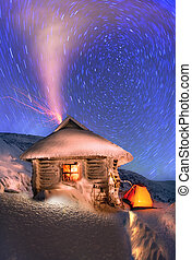 Tents and shelter Located on the slopes of the highest mountain of Ukraine Hoverla Alpine New Year's Eve and colored lights in the sky, brings joy to its exotic and extreme