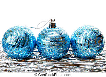 Christmas holiday tinsel with blue balls isolated on white