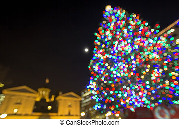 Christmas Holiday Tree with Moon at Pioneer Courthouse Square in Portland Oregon Downtown with Blur Defocused Bokeh Colorful Lights at Night