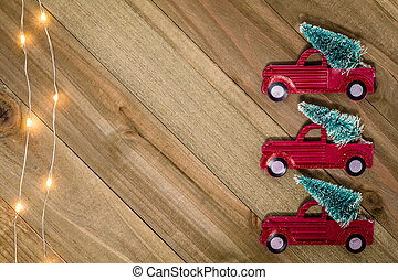 Christmas Holiday Winter still life concept on wooden board with vintage red truck and tree decor, flat lay room for text copy