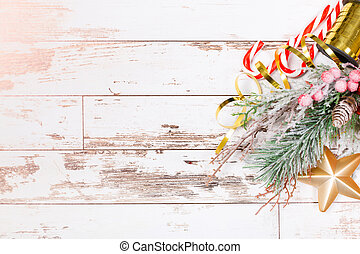Christmas holidays art composition on white wooden background with Christmas tree decoration and copy space for your text.