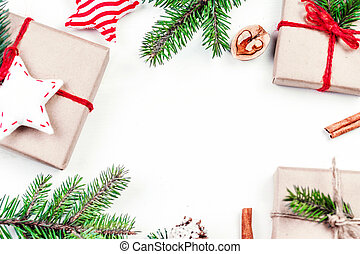 Christmas holidays background with festive decorations and gift boxes on white wooden board. Flat lay, top view