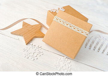 Christmas holidays background with festive decorations and gift boxes on white wooden board with copy space for your text mockup