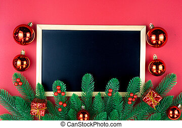 Christmas holidays composition, top view of red Christmas decorations and blackboard on red background with copy space for text. Flat lay, winter, postcard template, new year concept.