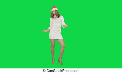 Christmas Holidays young attractive woman dancing on a Green Screen Chrome Key