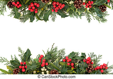Christmas floral border with holly, ivy, mistletoe, pine cones and winter greenery over white background.