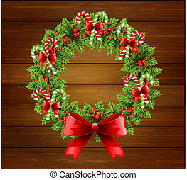 Christmas holly wreath in wood background