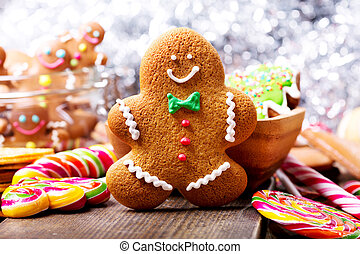Christmas homemade gingerbread man and sweets on wooden table