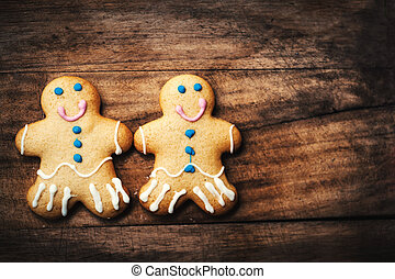 Christmas homemade gingerbread man cookie on wooden table. Christmas Holiday Background with copy space