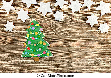 christmas homemade tasty gingerbread cookies on wooden background
