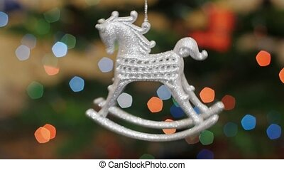 Christmas horse toy rotates at background bokeh