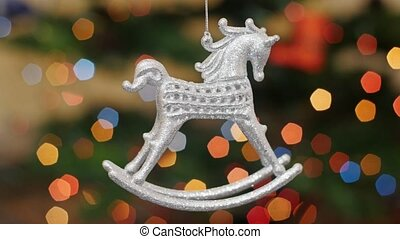 Christmas horse toy shakes at background bokeh