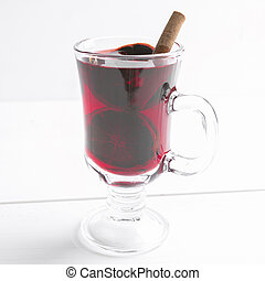 Christmas hot wine with orange, star anise and cinnamon over white background
