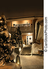 Christmas house entrance - Snowy entrance of house in...