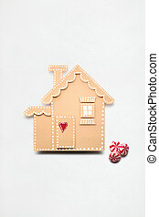 Christmas house. - Creative concept photo of a paper house...