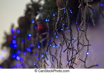 Christmas illumination color, with garlands in the form of a wall