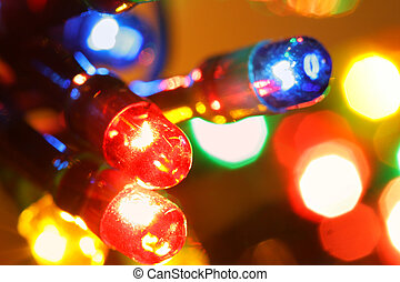 Christmas illumination - Colorful electric light bulbs close...