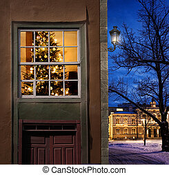 Christmas in snowy little town - Christmas tree home seen ...
