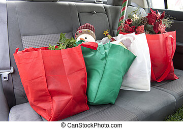 Christmas in the Back Seat - The back seat of a car with...