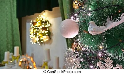 Christmas interior tree and New Year toys blinking room lights and fireplace