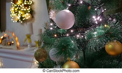 Christmas interior tree and New Year toys blinking lights and fireplace