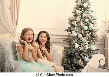 Christmas interior. xmas online shopping. Family holiday. Happy new year. Winter. The morning before Xmas. Little girls. Christmas tree and presents. Child enjoy the holiday