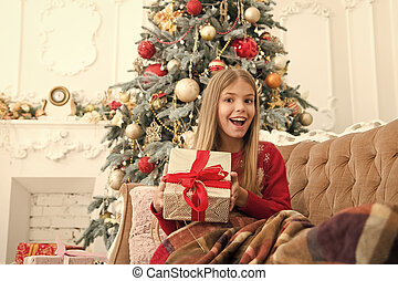 Christmas is coming. The morning before Xmas. Little girl. Happy new year. Winter. xmas online shopping. Family holiday. Christmas tree and presents. Child enjoy the holiday