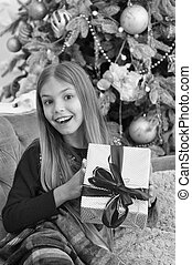 Christmas is here. xmas online shopping. Family holiday. Happy new year. Winter. The morning before Xmas. Little girl. Christmas tree and presents. Child enjoy the holiday
