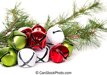 Christmas jingle bells and pine branch on a white background