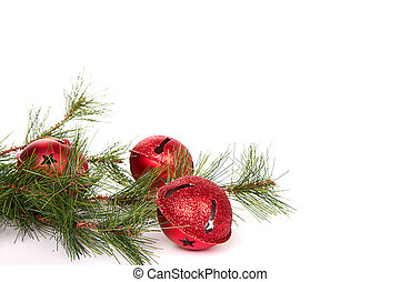 Christmas jingle bells with a pine branch on a white ...