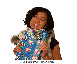 A young and pretty mixed race girl holds a holiday gift, isolated on white.
