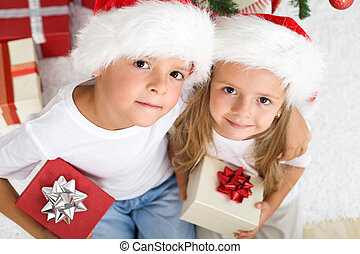 Christmas kids with santa hats and presents