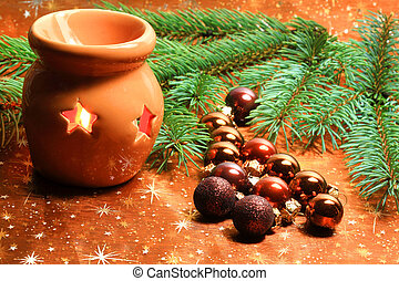 Christmas decoration with candle lantern and brown glass balls