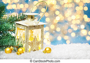 Christmas lantern and Fir in the snow