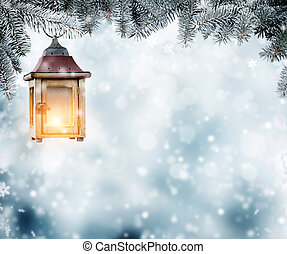 Christmas lantern hanging on fir branches. Copyspace for...
