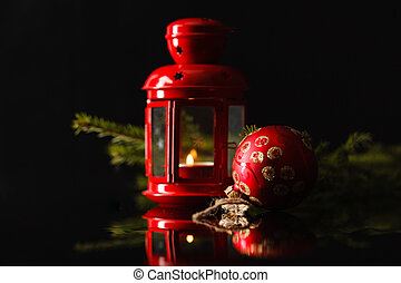 Christmas lantern in night on old wooden background. focus on the wick candles