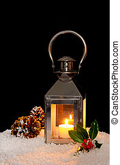 Christmas lantern in the snow.