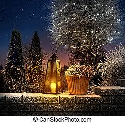 Christmas lantern in winter garden