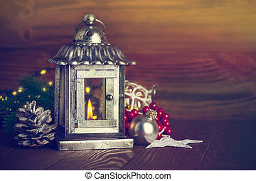 Christmas lantern with fir and tinsel