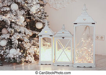 Christmas lantern with ornaments and snow in sepia tone near...