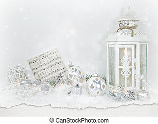 Christmas lantern with ornaments in snow
