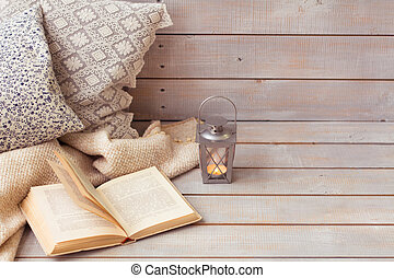 Christmas Lanterns and open book on wooden background. Copy...