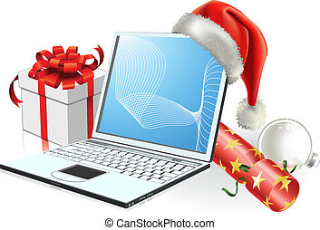 Christmas laptop computer with Santa hat, gift cracker and...