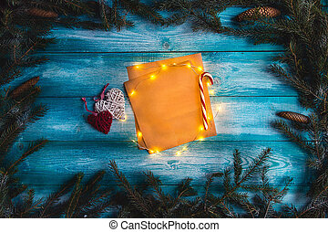 Christmas letter to Santa on a wooden blue table.