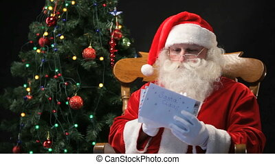 Christmas letters - Santa Claus sitting in the chair and...