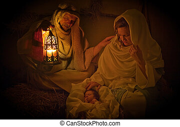 Christmas light in a manger - Living christmas nativity...