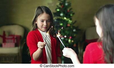 Christmas Light - Charming little girl holding a Bengal...