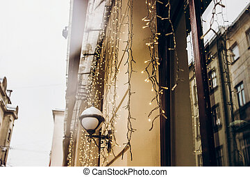 christmas lights decoration in snowy city streets. european city preparing for winter christmas holidays, space for text. beautiful outdoor illumination